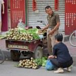 Chinese street seller — Stock Photo #9573783