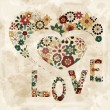 "Vector spring  flowers organized in heart shape and word ""love"" — Imagen vectorial"
