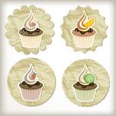Conjunto de vetores de cupcakes em guardanapos dourados — Vetor de Stock