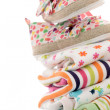 Newborn baby clothing - Stock Photo