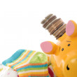 Newborn baby clothes and piggy bank — Stock Photo