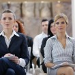 Business woman standing with her staff at conference — Stock Photo #10003046