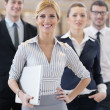 Business woman standing with her staff at conference — Stock Photo #10003790