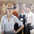 Business woman standing with her staff at conference — Stock Photo #10003866