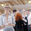 Business woman standing with her staff at conference — Stock Photo #10003884