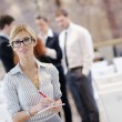 Business woman standing with her staff at conference — Stock Photo #10003963