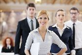 Business woman standing with her staff at conference — Stock Photo