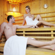 Постер, плакат: Happy young couple in sauna