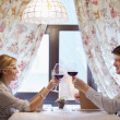 Young couple having dinner at a restaurant — Stock Photo #10015439