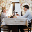 Young couple having dinner at a restaurant — Stock Photo