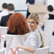 Business woman giving presentation - Stock Photo