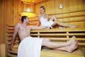 Happy young couple in sauna — Stock Photo