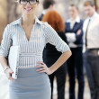 Business woman standing with her staff at conference — Stock Photo #10034440