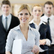 Stock Photo: Business woman standing with her staff at conference
