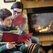 Young romantic couple relax on sofa in front of fireplace at hom — Stock Photo #10035177