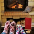 Young romantic couple relax on sofa in front of fireplace at hom — Stock Photo #10037395