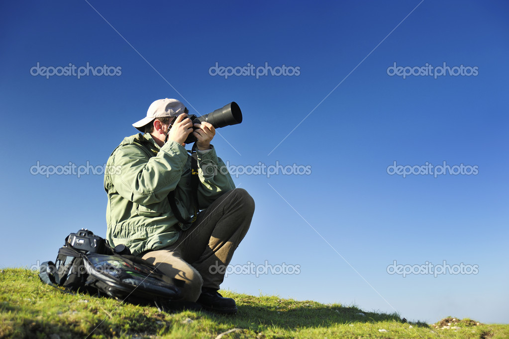 Nature photographer with digital camera on top of the mountain — Stock Photo #10049135