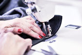 Hands of Seamstress Using Sewing Machine — Stock Photo