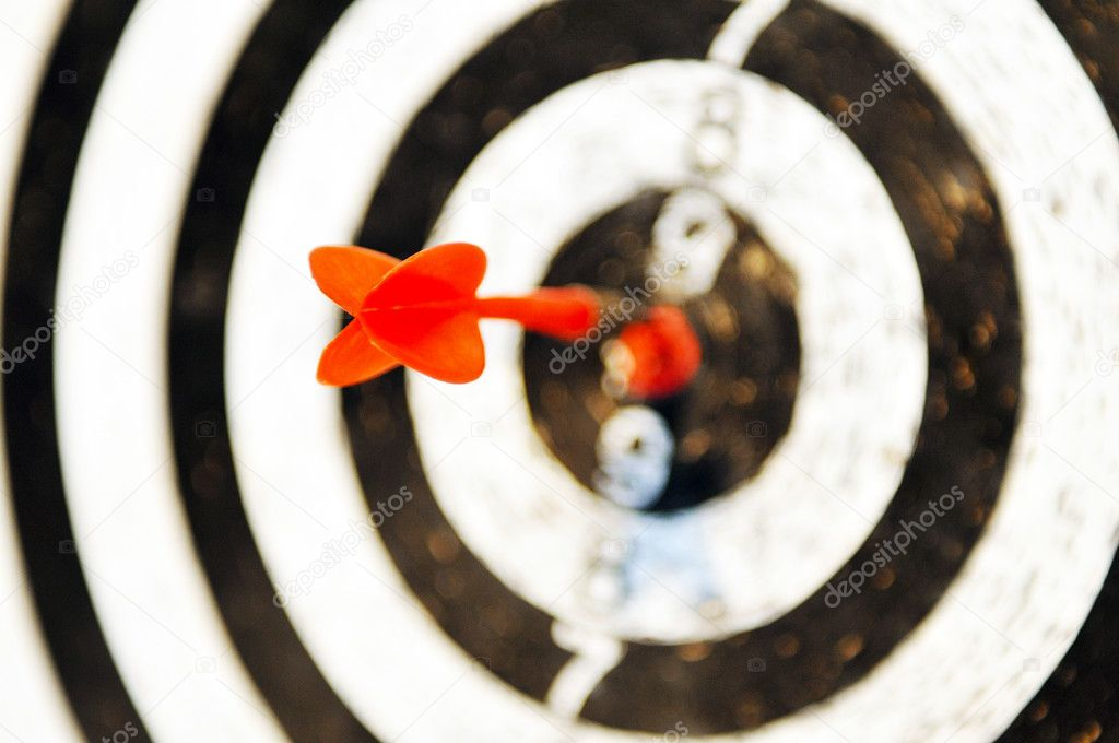 Success in marketing and business concept with dart sport game target — Stock Photo #10075703