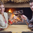 Young romantic couple sitting and relaxing in front of fireplace at home — Stock Photo #10082553