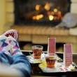 Young romantic couple sitting and relaxing in front of fireplace at home — Stock Photo #10082721
