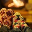 Young romantic couple sitting and relaxing in front of fireplace at home — Stock Photo