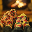 Stock Photo: Young romantic couple sitting and relaxing in front of fireplace at home