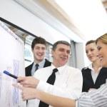 Senior business man giving a presentation — Stock Photo