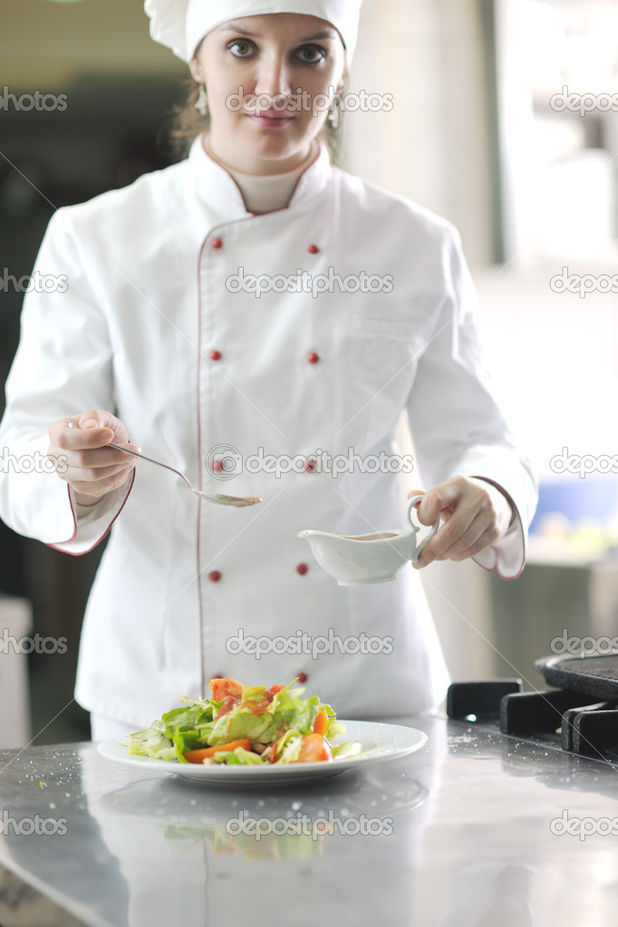 Beautiful young chef woman prepare and decorating tasty food in kitchen — Stock Photo #10082929