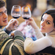 Young romantic couple sitting and relaxing in front of fireplace at home — Foto de Stock