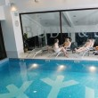 Young group at spa swimming pool — Stock Photo
