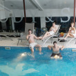 Young group at spa swimming pool - Stock Photo