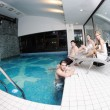 Young group at spa swimming pool — Stok fotoğraf