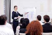 Business woman giving presentation — Stock Photo