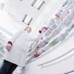 Pharmacist chemist woman standing in pharmacy drugstore — Stock Photo