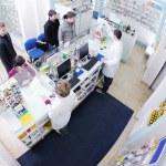 Pharmacist suggesting medical drug to buyer in pharmacy drugstore — Stock Photo #10575051