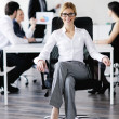 Business woman with her staff in background — Stockfoto