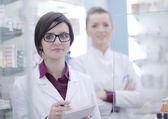 Team of pharmacist chemist woman in pharmacy drugstore — Stock Photo