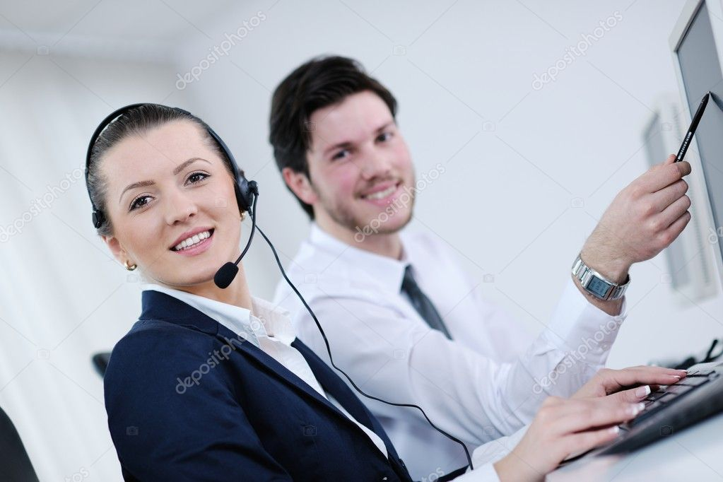 Business group with  headphones giving support in  help desk office to customers, manager giving training and education instructions  Stock Photo #10575398