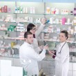 Stock Photo: Pharmacy drugstore team