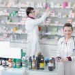 Team of pharmacist chemist woman in pharmacy drugstore — Stock Photo