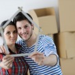 Young couple moving in new house — Stok fotoğraf