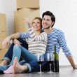 Young couple moving in new house — Stock Photo #10627547