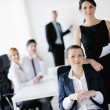 Business woman with her staff in background — Stock Photo #10652827
