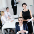 Business woman with her staff in background — Stock Photo #10652847