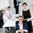 Stock Photo: Business woman with her staff in background
