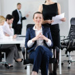 Business woman with her staff in background — Stock Photo #10652871