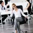 Business woman with her staff in background — Stock Photo #10652891