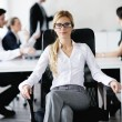 Business woman with her staff in background — Stock Photo #10652902