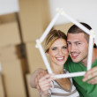 Young couple moving in new house — Stock Photo #10695991